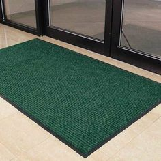 """Brush Step Mat Color: Green, Size: 3' x 4' by Design by AKRO. $41.99. 109S0034GN Color: Green, Size: 3' x 4' Features: -Origin: United States.-Lighter-weight double rib high/low design.-Performs the scraping function of the mat.-Ribbed surface brushes, channels and conceals dirt and debris.-Perfect choice for light to medium traffic areas. Dimensions: -Pile height: 0.4""""."""
