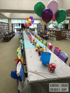 Mad Hatter Tea Party event at Asheboro Library RCPL #wonderland #librarythings #asheborolibrary #madhatterteaparty #decor #games