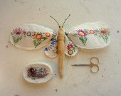 Moth made from vintage tablecloth.