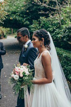Walking down the aisle #bride #boho #flowyweddingdress #bouquet #blushpink #ivorydress #navysuit #fatherofthebride