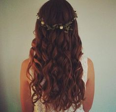 This would be so pretty for a wedding! Its simple but the curls and white flowered headband make it elegant.