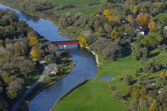 An aerial view of the West Montrose Covered Bridge and surrounding rural landscape. Township of Woolwich, 2007 Largest Countries, Countries Of The World, Ontario, Canada Pictures, Gone Days, Local History, Covered Bridges, Aerial View, Scenery