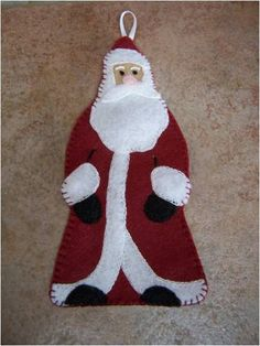 """I've made a similar Santa using burgundy instead of red, and ivory/cream instead of white. I also added a """"rusty"""" bell for him to hold, but you could use a """"rusty"""" star...I also stuffed him a bit with polyester fiberfill..."""