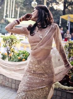 Love the sari blouse and nude sleeves!