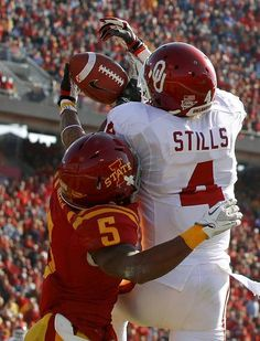 Oklahoma's Kenny Stills (4) catches a touchdown pass beside Iowa State's Jeremy Reeves (5) during a college football game between the University of Oklahoma (OU) and Iowa State University (ISU) at Jack Trice Stadium in Ames, Iowa, Saturday, Nov. 3, 2012. Photo by Bryan Terry, The Oklahoman