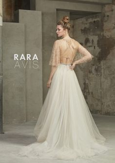 Wedding dress Holli by Rara Avis. Deep V-neck transparent and thin creamy fabric embroidery style floral patterns. Available at Luxx Nova. Ship worldwide. Based in Vancouver, Canada.