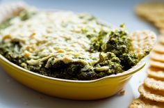 Vegan Spinach Dip  vegan, makes about 5-6 cups    16 oz. organic frozen spinach, thawed  3 cloves of garlic and/or 1 Tbsp garlic powder  1/4 cup lemon juice  1-2 Tbsp apple cider vinegar (or more lemon juice)  1 cup 'quick-soaked' raw cashews  1/2 cup raw parsley  1 cup raw arugula  2-3 Tbsp Nutritional Yeast Flakes  1-2 Tbsp Vegenaise Spread or drizzle of EVOO (opt'l)  1 tsp sea salt  1 tsp black pepper  Topping: Sprinkle of Vegan White Cheese (Daiya)