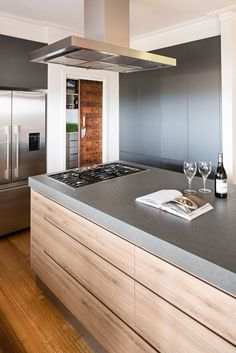 Contrasting benchtops, custom made pantry door and handleless doors and drawers.