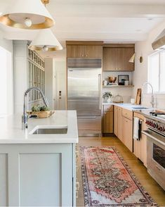 Two tone kitchen, small open kitchen, 2 sinks in kitchen, wood, white, and color in kitchen