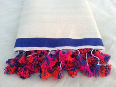 large Moroccan wool blankets woven by hand with pom poms / moroccan wool throw