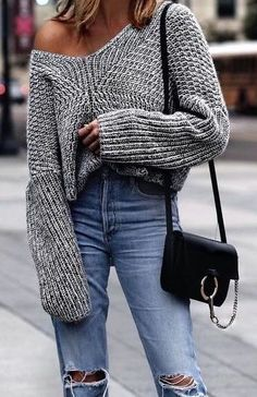 Off-the-shoulder sweater, high-waisted jeans + a black purse. #gray #denim #falloutfit