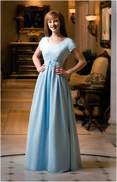 Eternity Gowns 129  Chiffon gown with an empire waistline that has beaded embroidery on the bodice and a full skirt with side ties that may be tied in front or in back. Gown has extra fullness in the skirt.