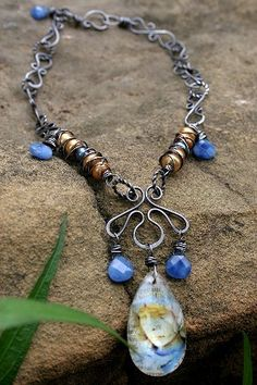 Spiritual Life by mocknet on Etsy - love the squigly piece that the pendants are suspended from.