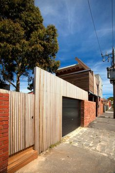 Transformer House, Breathe Architecture, by Eugenia Lim. Transformer House sits behind red brick walls on a 50m2 parcel of land, the smallest sub-division in the City of Moreland. An angular, timber-clad roof encases its first floor, folding in and away from a towering transformer, from which the project takes its electrified name. With a suite of obstacles, this design challenge in utilitarian sustainability was no sweat for Brunswick's Breathe. Photo by Andrew Wuttke.