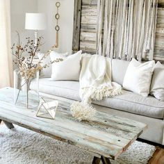 What inspires me...muted neutral tones, old rustic wood and branches. Dried branches in our home m...