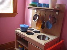 Building your own play kitchen using items from IKEA for under 50 bucks! I would so love to do this