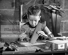 Boy making a model airplane