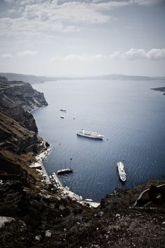 """Ormos"", Fira old Port, Santorini - The hairpin turns on the road out of here will take your breath away. Especially the mad rush by all forms of vehicle to leave the area."