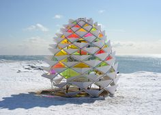 Toronto lifeguard towers converted into winter pavilions.   Diana Koncan and Lily Jeon, architecture and engineering students from nearby Ryerson University, produced Snowcone. Shaped like a pine cone, the shelter comprises a metal frame and rainbow-coloured translucent skin. From @dezeen.