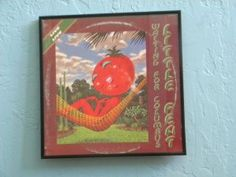Framed Vinatge Record Album Cover - Waiting for Columbus - Little Feat  Little Feat was formed in Los Angeles, California in 1969 by former members of the Mothers of Invention, Frank Zappa's band.  The first live album by Little Feat, Waiting for Columbus was recorded in 1977, including four performances at the Rainbow Theatre in London.