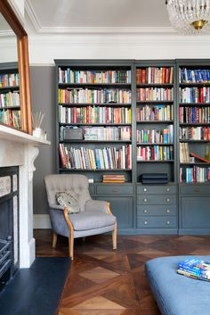Shelgate Road, Battersea - Granit Architects. Dark, classic shaker style joinery. Library. Free standing furniture.