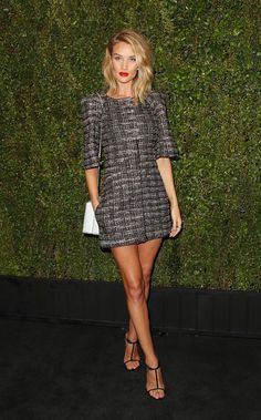 The supermodel stunned in a Chanel tweed mini, Chanel fine jewelry, and a gray Chanel handbag.