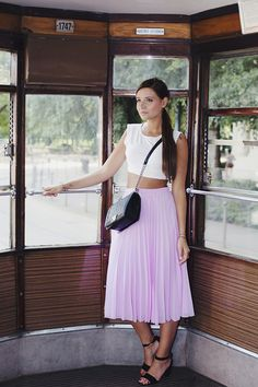Beautiful lilac pleated skirt with simple white crop top tank supported with a black leather satchel