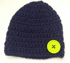 Crocheted navy blue toddler beanie with large lime green button accent by KustomizedByKat on Etsy $10