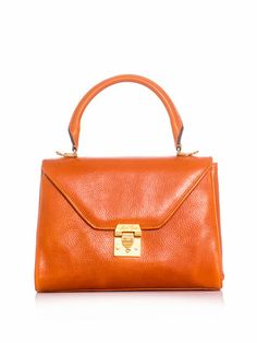 Mark Cross Scottie bag. It's smallish, classic and goes fabulously well with 60's and 40's styles. Ladies didn't carry huge bags back then.