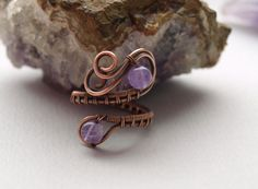 This beautiful ring was carefully wrapped with copper wire, the stones is Amethyst. Adjustable size. This ring can be a perfect gift for woman or girlfriend. It comes gift wrapped and ready for giving! ***Dimension:*** - Adjustable size. Not exactly what youre looking for? More of my rings available here: https://www.etsy.com/shop/7Stone?ref=hdr&section_id=20213568 ***Material:*** - Copper wire, Amethyst . In my shop you can find an unique jewelry create...
