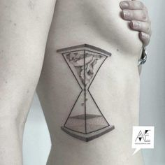 body side hourglass tattoo dotwork