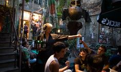 Waitress service in Berlin's Mitte district. The local joke is that the Greeks order and the Germans get the bill. Photograph: Thomas Peter/...