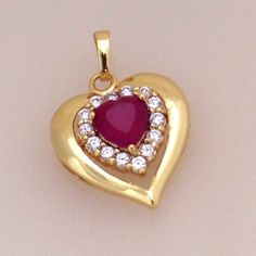 18K032-18 karat Gold plated Heart shaped pendant embedded with Fuchsia and clear cubic zirconia stones  http://www.craftandjewel.com/servlet/the-801/18K032-dsh-18-karat-Gold-plated/Detail