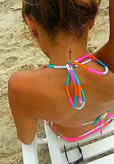 Cute small cross tattoo, beachy tattoo ,tattoo on the back of the neck.