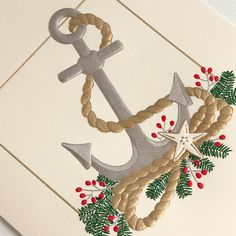 Engraved Anchor Holiday Greeting Card: Let's set sail on a sleigh that prefers dolphins to Dasher and Dancer. Season's greetings from the seaside, courtesy of an anchor surrounded by all the nautical trimmings.