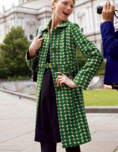 green polka dot coat