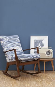 I love everything on this picture! Mini Moderns Environmentally Responsible Paint: Washed Denim. Whitby fabric covered chair. Radio. Floor.