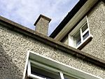 Roughcast or pebbledash is a coarse plaster surface used on outside walls that consists of lime and sometimes cement mixed with sand, small gravel, and often pebbles or shells.