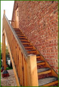 staircase design to tie in with porch design Staircase Outdoor, Timber Staircase, Wooden Staircases, Staircase Design, Detached Garage Designs, Staircase Remodel, Attic Remodel, External Wooden Doors, Outside Stairs