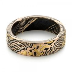 #103470 This elegant wedding band features an organic mokume gane pattern, accented with oxidized and brushed finishes. It was created for a client from Portland, OR, who found...