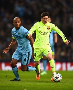 Vincent Kompany of Manchester City challenges Lionel Messi of Barcelona during the UEFA Champions League Round of 16 match between Manchester City and Barcelona at Etihad Stadium on February 24, 2015 in Manchester, United Kingdom.