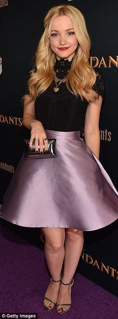 Coordinating: Dove Cameron sported a two-toned black and pink dress, matching her top with...