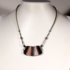 Art Deco silver plated neclace set with dark and light brown bakelite motif. The chain as snake skin ending with bakelite beads intercalated with