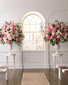Ceremony Arrangements The altar is flanked by a pair of glazed ceramic urns that hold classic, painterly arrangements of peonies in bright pink, light pink, and blush. Mixed in are snowball viburnum and mock orange. These majestic urns can be transported to the reception and used again there.