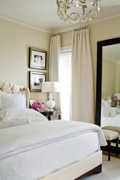 Classic beauty. Tans and white with a pop of color. I love the headboard, too.