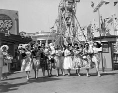 1950sunlimited:  Miss Universe Contestants 1958 Contestants and their teddy bears march together through Carnival Row and enjoy some hot dogs in Nu-Pike Park, Long Beach, CA.  Looks like they made the old boy's day.