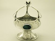 A fine and impressive antique Edwardian English sterling silver and glass enamel bon bon dish in the Arts & Crafts Style; an addition to our silver presentation collection  http://www.acsilver.co.uk/shop/pc/Sterling-Silver-Bon-Bon-Dish-Arts-and-Crafts-Style-Antique-Edwardian-54p4400.htm