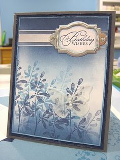 Blue Watercolor - Stamps: Watercolor Trio  Cardstock: Basic Grey, Night of Navy, Marina Mist, Whisper White, Acetate  Ink: Marina Mist, Night of Navy, Whisper White Craft  Accessories: Brayer, Silver Hodgepodge Hardware, Whisper White Organza ribbon, Designer Label Punch, Beautiful Wings Embosslit Die, Mini Glue Dots, Basic Pearl Jewel Accents, Irridescent Ice Embossing Powder