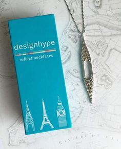 "Inspired by the beautiful Chrysler Building in NYC, our Chrysler Necklace has all of the details of this art deco masterpiece and is the perfect travel souvenir and gift for the woman who wants to add wanderlust jewelry to her collection.       Details   Free shipping in the USA Engraved details of the Chrysler Building Tarnish resistant, recyclable Stainless Steel  Finishes  Shiny  Size  3-1/8"" long pendant 24"" Stainless steel ball chain"