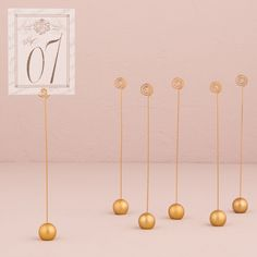 These stylish classic round table number holders have an understated yet classic design that will be the perfect complement for a wide range of stationery and tabletop decor. Use to display table numbers, menus or other small messages intended for. Gold Table Number Holders, Table Number Stands, Gold Table Numbers, Wedding Table Numbers, Wedding Tables, Reception Table, Reception Ideas, Wedding Reception, Sell Your Wedding Dress